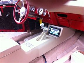 Custom center console built for 1969 Camaro with car stereo and Navigation.